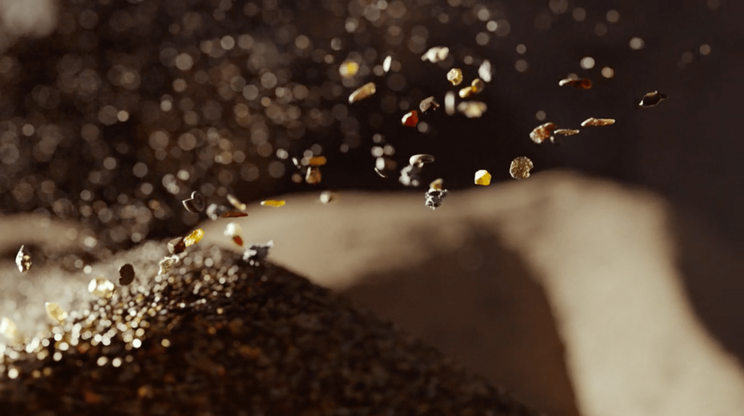 Fragments of shells, crystals and specks of volcanic rock CGI